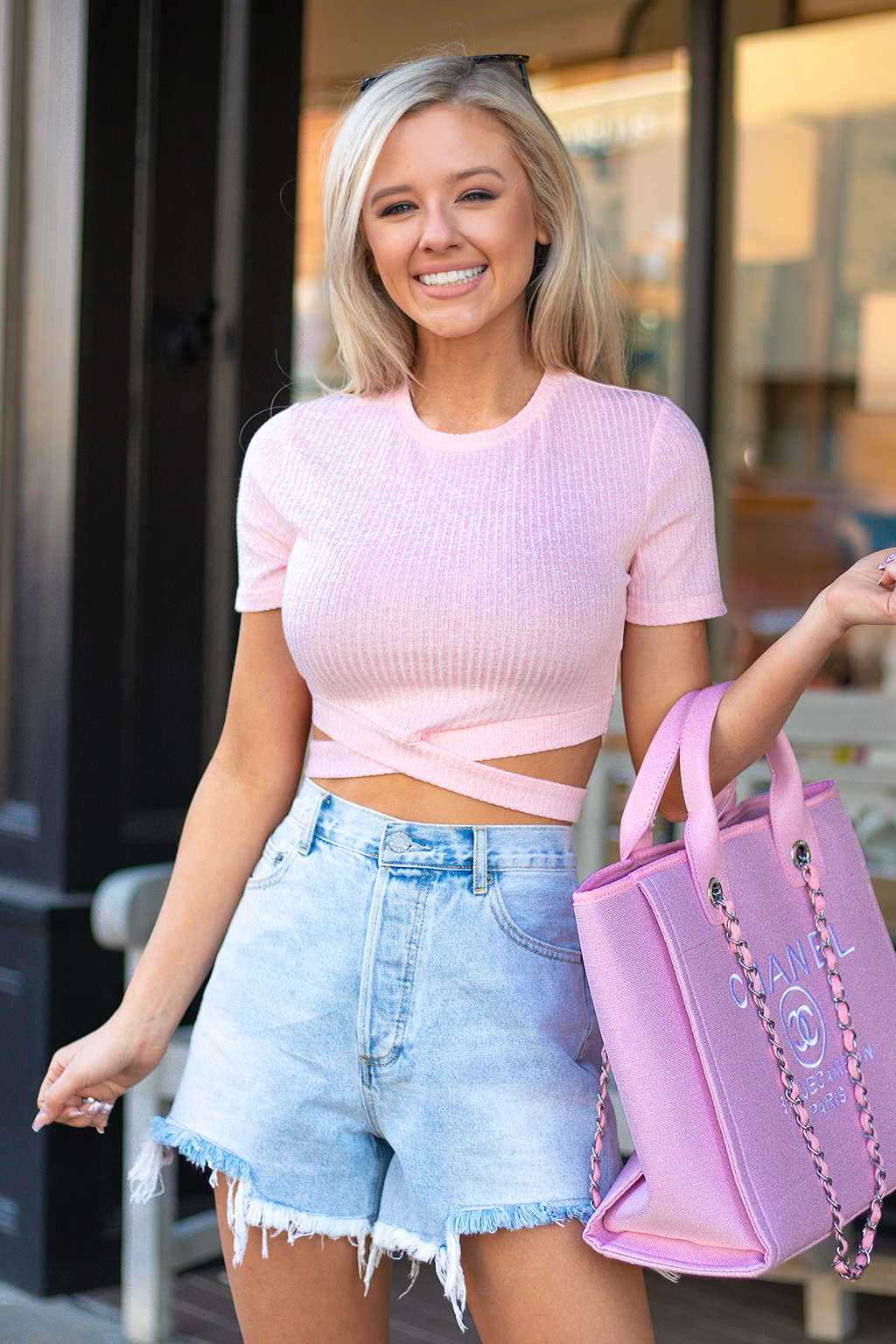 CUTOUTS ARE SO BACK. WE ARE SEEING DRESSES, TOPS, AND EVEN SKIRTS WITH FUN LITTLE CUTOUTS LIKE THIS. WE ARE SO EXCITED TO BRING THEM TO YOU. -Taylor is wearing a size small -color: pink -cropped  -stretchy material  -ribbed material
