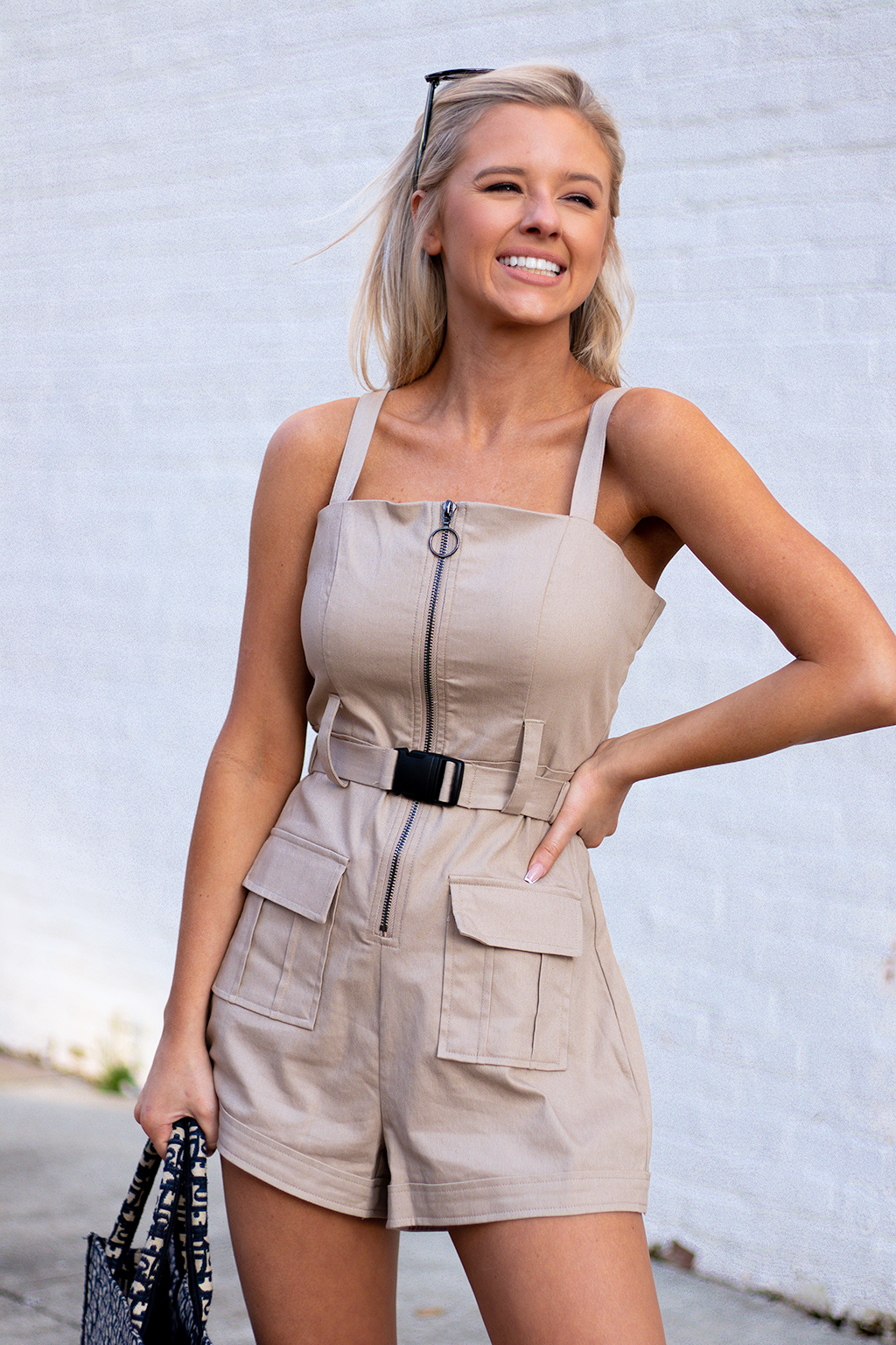 GETTING HUGE MUSIC FESTIVAL VIBES FROM THIS ROMPER. WE ARE BEGGING Y'ALL TO ROCK THIS EVEN FROM HOME TO FEEL THE SAME WAY. -Taylor is wearing a size small -color: tan -industrial belt design -detachable belt -adjustable straps