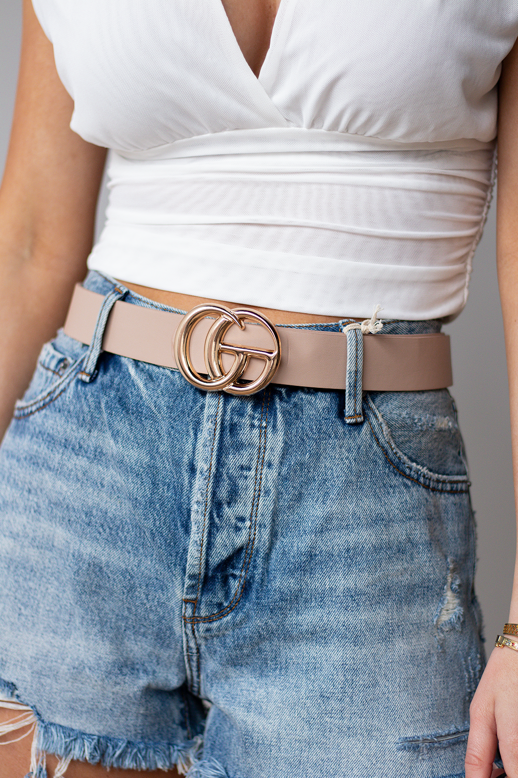 OOO look at it in tan. y'all continue to sell out our Gucci Look A Like belts and we know this one is such a staple that it will go even faster.    -ONE SIZE FITS MOST