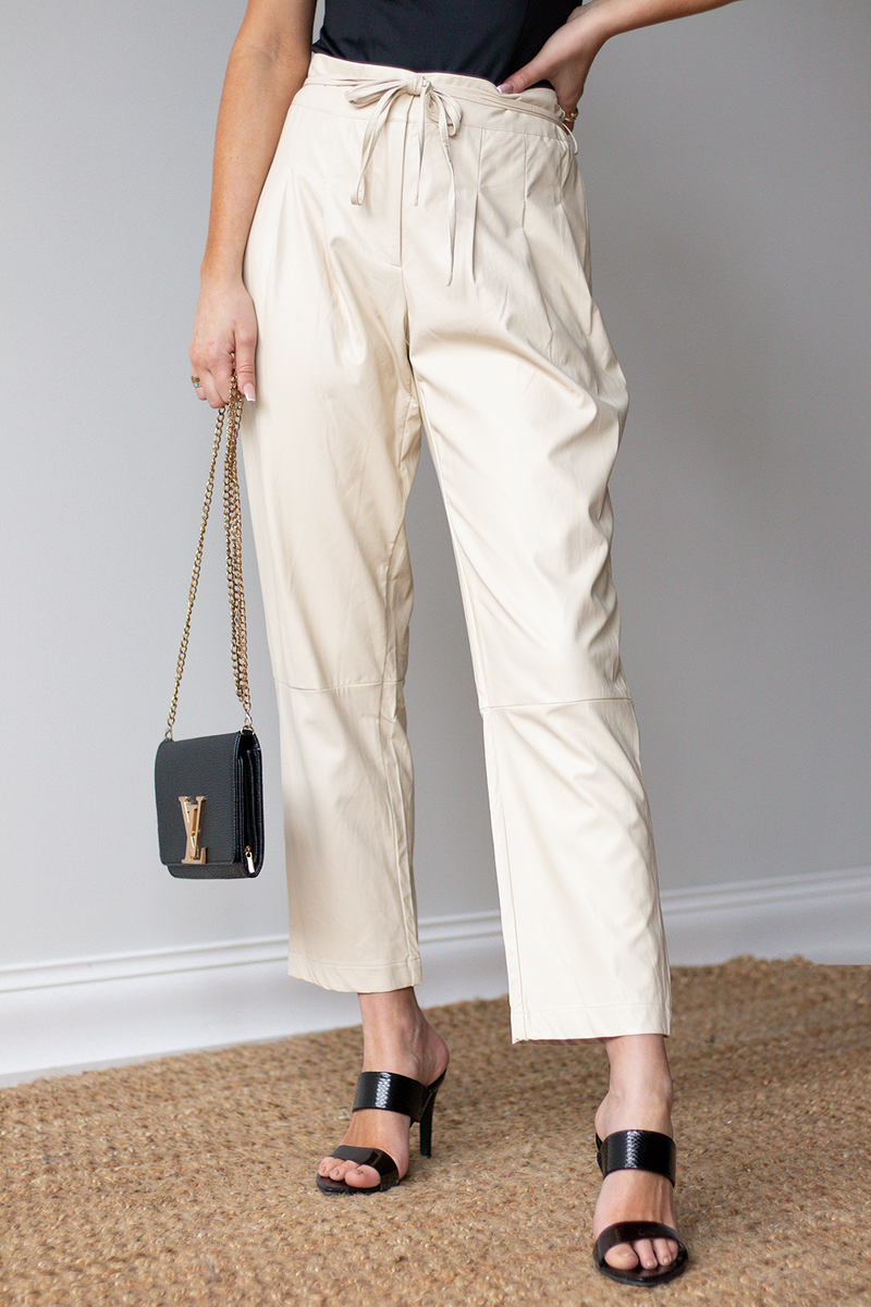 LIKE A GIRL ON A MISSON THESE PANTS ARE UNSTOPPABLE. WE LOVE THE BAGGY FIT THAT GIVES US A CHIC WOMAN ON THE GO LOOK. -Taylor is wearing a size small -Color: creamy/light tan -faux leather  -stringy tie design  -pairs great with a black bodysuit like pictured