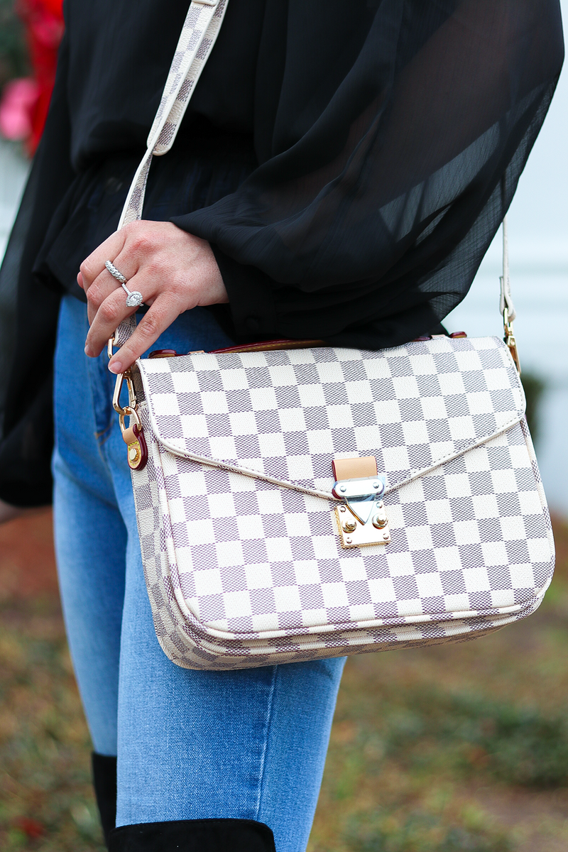 A BAG THAT IS AN EVERYDAY MUST HAVE. THIS CREAM CHECKERED BAG HAS GREAT STORAGE AND TWO STRAPS FOR ALL YOUR FAVORITE LOOKS.