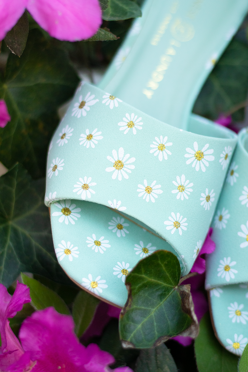 THESE HEELS ARE SUCH A FUN WAY TO DRESS UP ANY OUTFIT. THE TINY DAISIES WITH GOLD FLECKS OF SPARKLE ARE JUST TOO CUTE. -light green color -about a 1.5 -2 inch heel -look adorable with little white sundresses -The Shoe fits true to size. -If you're in-between sizes we suggest sizing up half a size