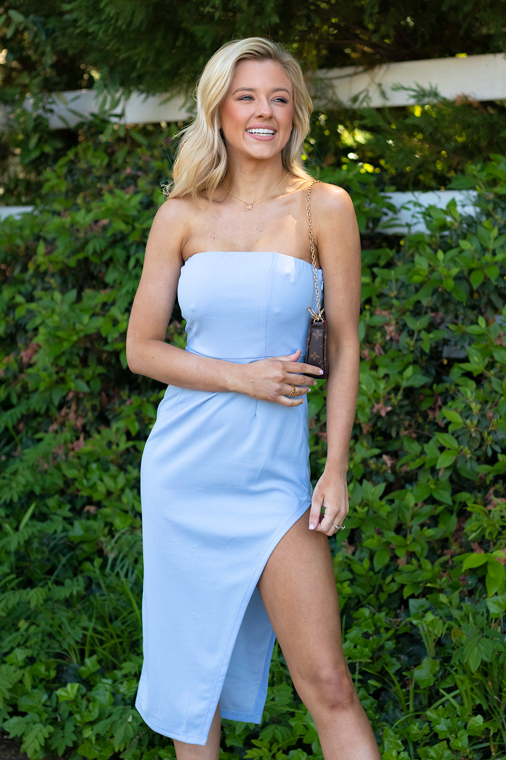 COME ON!! THIS DRESS IS TOO GOOD TO BE TRUE, ITS LITERALLY THE MOST FLATTERING MIDI STRAPLESS DRESS WE EVER DID SEE, PERFECT FOR DATE NIGHTS, EVENTS, AND WEDDINGS!! -Taylor is wearing the small -color: powder blue -strapless  -midi length  -slight slit