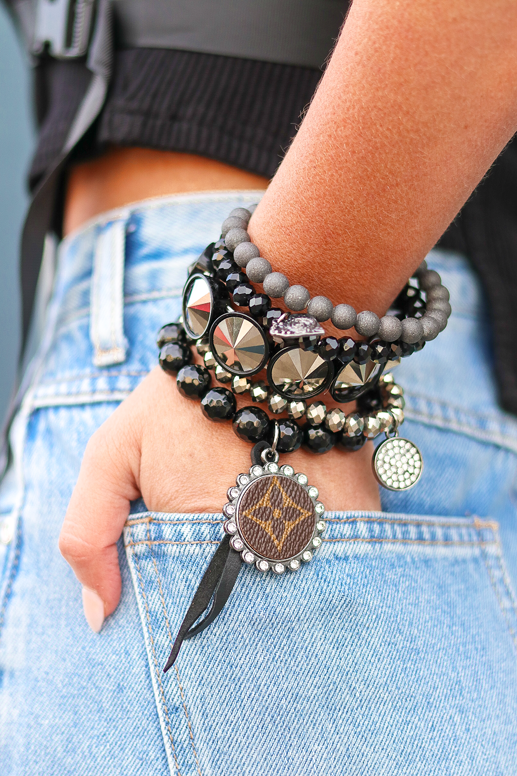 A LITTLE STACK FOR YOUR WRIST IS NEVER A BAD CHOICE. WE LOVE THIS BLACK BEADED SET WITH ADORABLE CHARMS. NOT TO MENTION IT IS REPURPOSED LOUIS VUTTION.