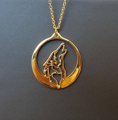 Gold wolf and moon necklace