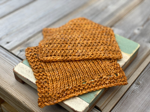 Two squares of fabric; one knitted and one crocheted