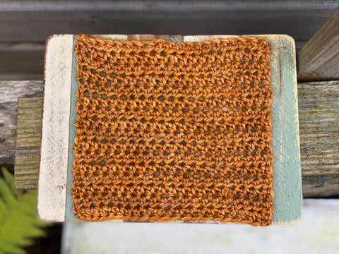A square of crocheted fabric