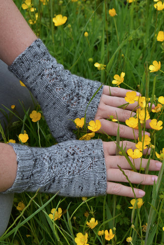 Grey fingerless mitts with yellow buttercups in the background