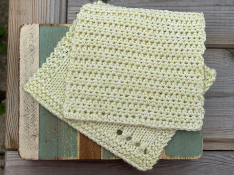 Two pale yellow squares; one knitted and one crocheted