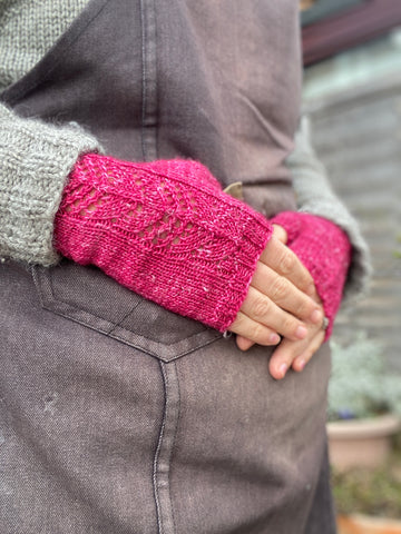 Bright pink fingerless mitts