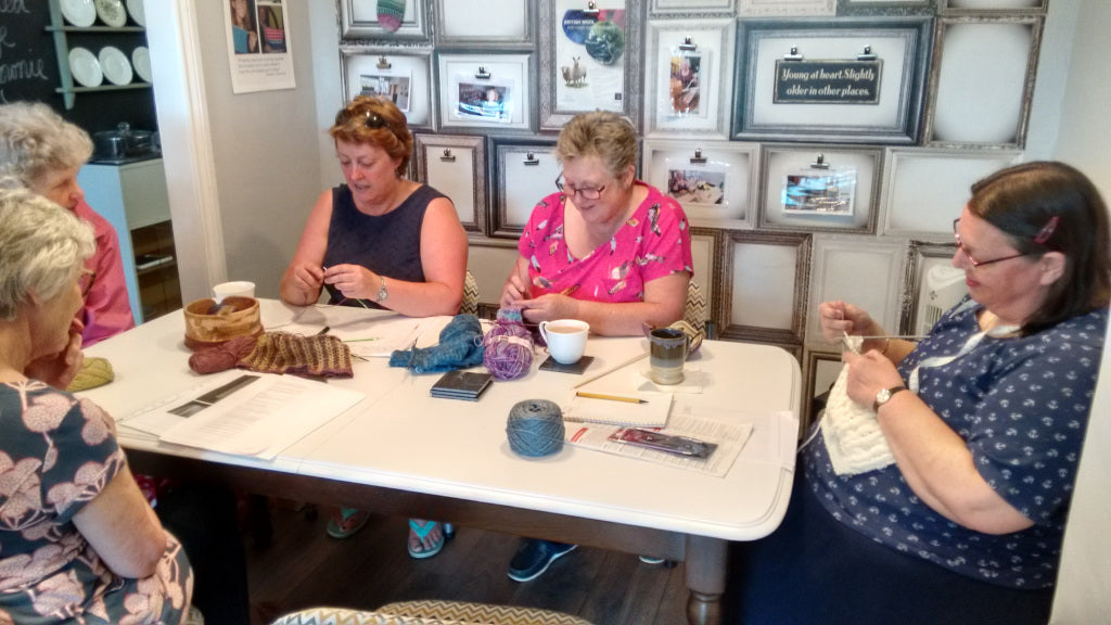 knitters at table