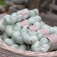 Pale green yarn with grey splashes