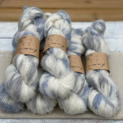 Variegated cream, blue and grey fluffy yarn