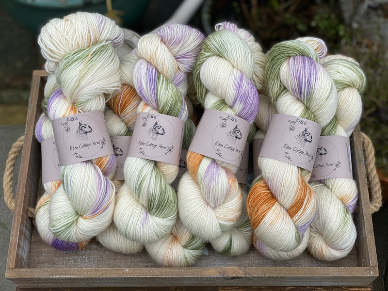 Variegated cream, green, brown and purple yarn