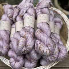 Pale purple yarn with brown speckles