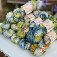 Variegated green, brown and blue yarn