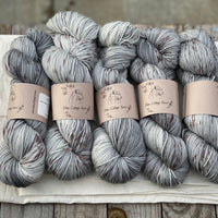 Variegated grey yarn with brown splashes