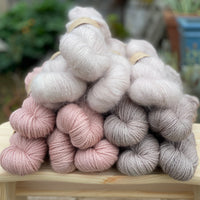 Yarns for the Woodbine Sweater in shades of pink and beige