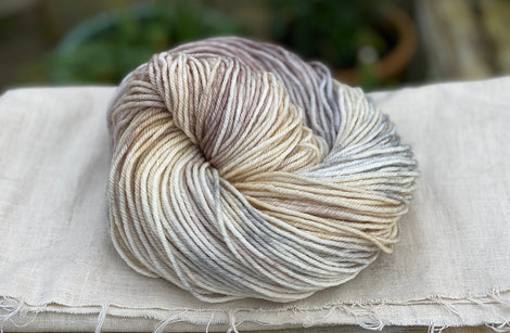 Variegated cream, yellow and brown yarn