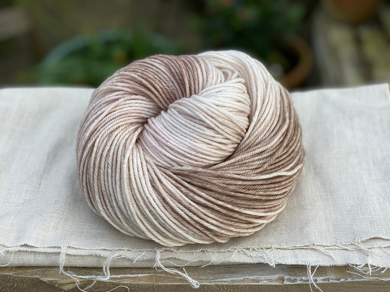 Variegated cream and brown yarn