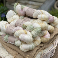 Variegated cream, green, pink and yellow yarn