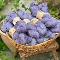 Purple yarn in a wicker basket