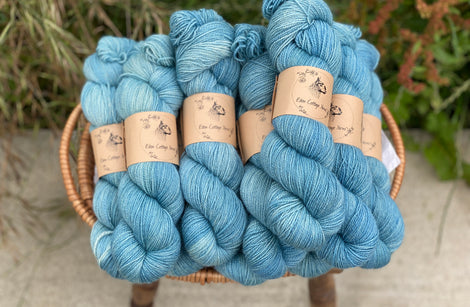 Blue yarn in a wicker basket