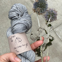 Grey yarn shown with its namesake flower