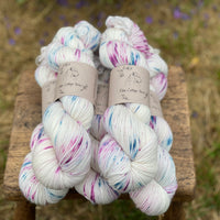 Cream yarn with speckles of blue and purple