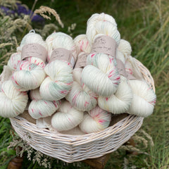 Cream yarn with dapples of green and red