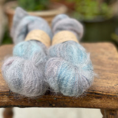 Variegated blue and purple fluffy yarn