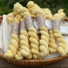 Yellow mini skeins of yarn