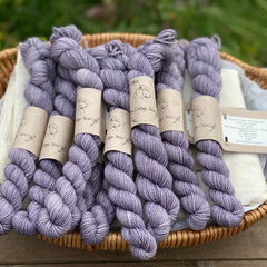 Purple mini skeins of yarn