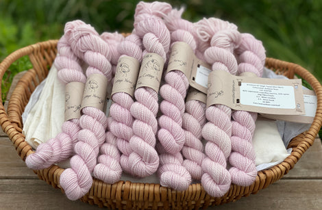 Pale pink mini skeins of yarn