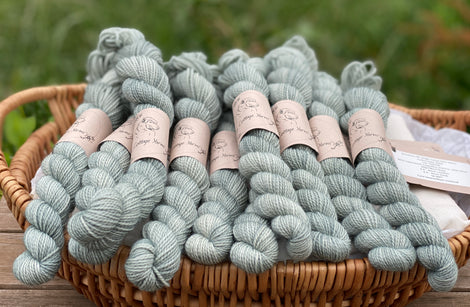 Grey mini skeins of yarn