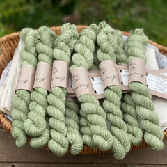 Green mini skeins of yarn