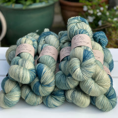 Variegated green and blue yarn with black speckles