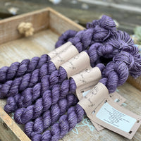 Purple yarn with gold sparkle