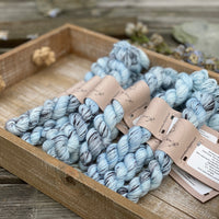Pale blue yarn with black splashes
