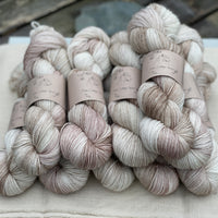Variegated cream and brown yarn with silver sparkle