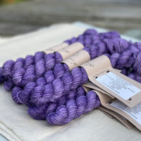Purple mini skeins of yarn with silver sparkle