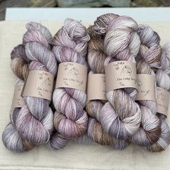 Variegated purple and brown yarn with gold sparkle