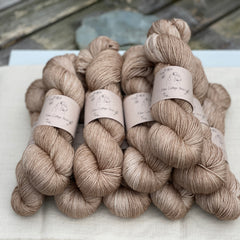 Light brown yarn with gold sparkle