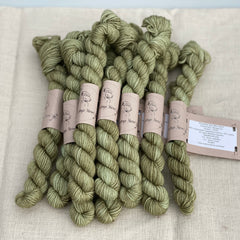 Green brown mini skeins of yarn with gold sparkle