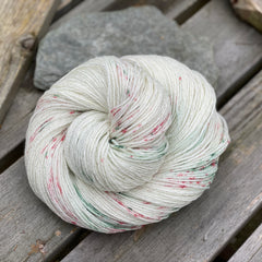 Cream sparkly yarn with splashes of green and red