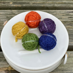 Five small balls of yarn in deep rich shades
