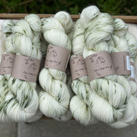 Cream yarn with splashes of green