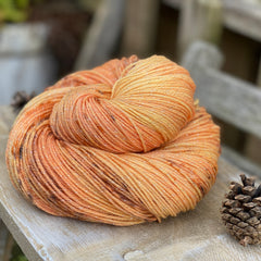 Lightly variegated orange yarn with speckles of black
