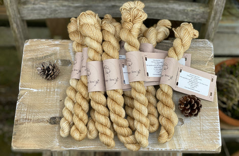 Light brown mini skeins of yarn