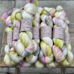 Variegated cream, yellow, pink and green yarn